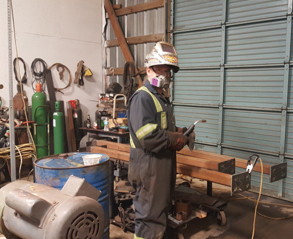 man with a welding torch