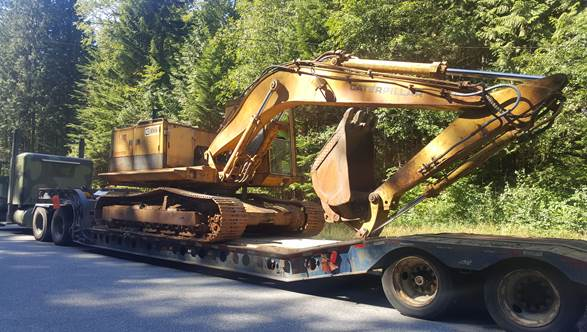 excavator being transported